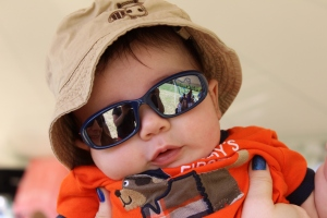 Sunglasses and a hat... its hard to be this cool.. or is it hot?  Liam's first summer.